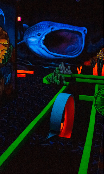 Enjoy an ocean-themed, neon golfing experience, aided by 3D glasses!